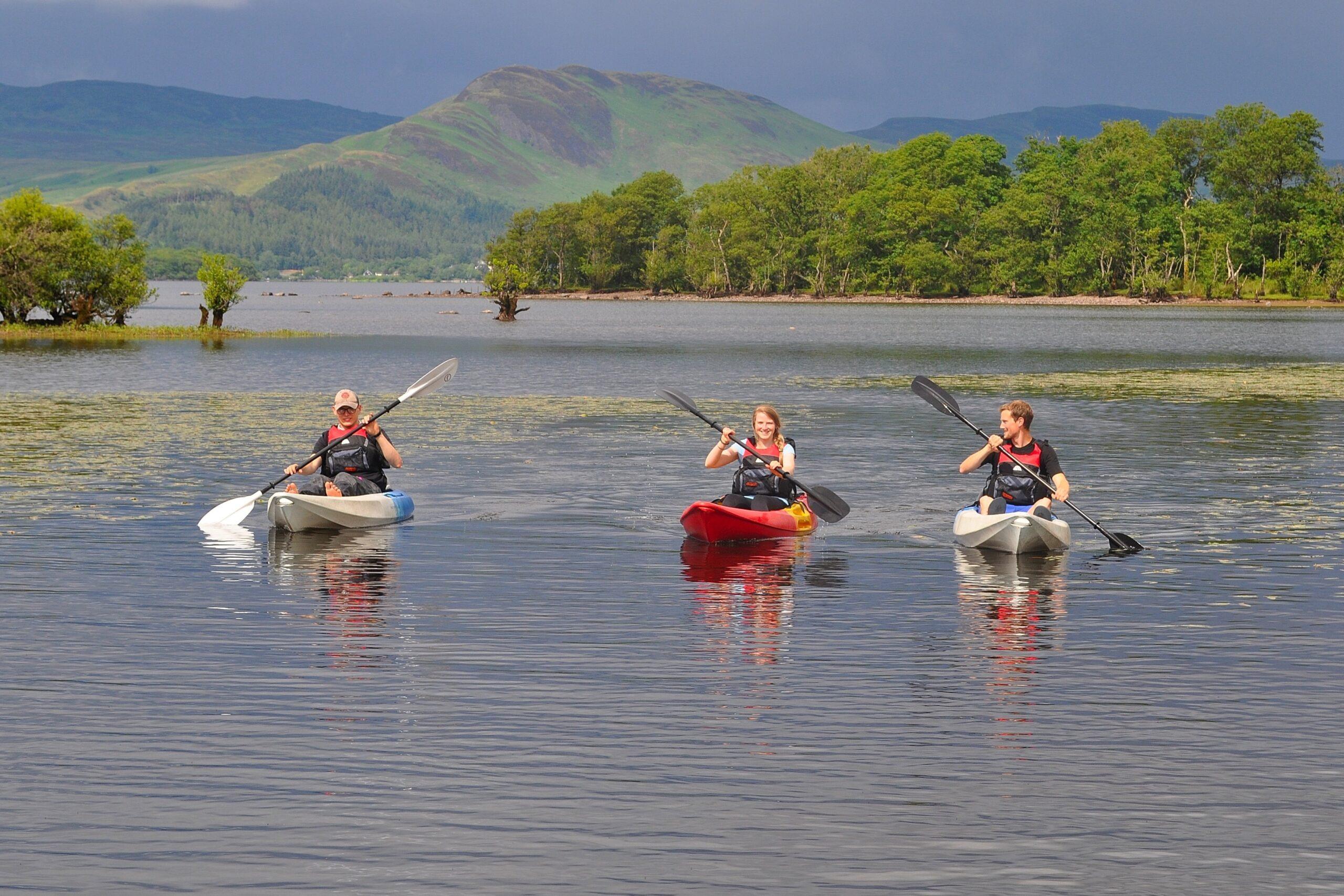 Three kayakers on Loch Lomond near Portnellan Farm